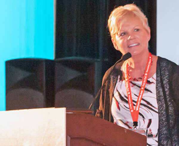 Barbara speaks from lectern at FAA Conference