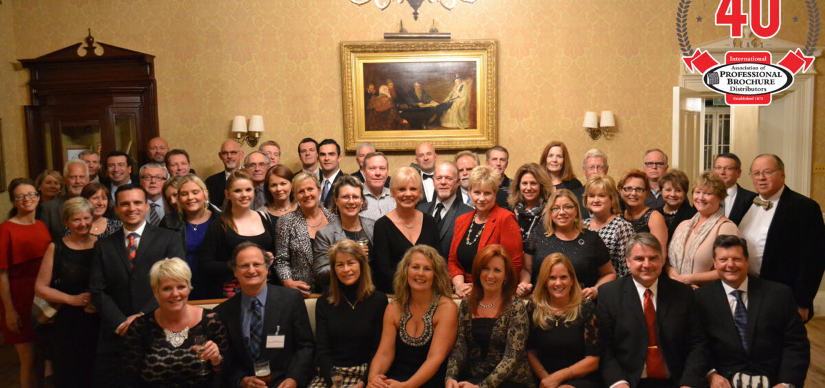 Barbara and Holly in large group photo with 40th anniversary logo